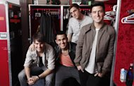 In this March 9, 2012 image, the boy band Big Time Rush, from left, James Maslow, Carlos Pena Jr., Kendall Schmidt and Logan Henderson, pose for a portrait in their dressing room at Radio City Music Hall in New York. Big Time Rush, who star on their own Nickelodeon TV show, is one of many boy bands who have recently emerged on the music scene since *NSYNC and Backstreet Boys dominated pop music in the 1990s. (AP Photo/Carlo Allegri)