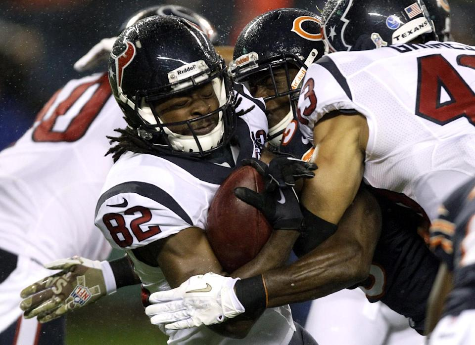 Houston Texans wide receiver Keshawn Martin (82) is tackled by Chicago Bears defensive back Zack Bowman during the first half of an NFL football game, Sunday, Nov. 11, 2012, in Chicago. (AP Photo/Nam Y. Huh)