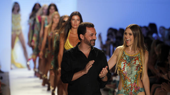 Cia. Maritima designer Benny Rosset, left, walks on the runway with models wearing his collection of swimwear during the Mercedes-Benz Fashion Week Swim 2013 show, Saturday, July 21, 2012, in Miami Beach, Fla. (AP Photo/Lynne Sladky)