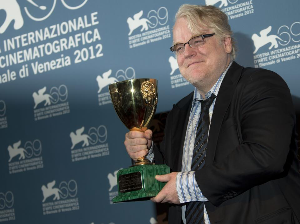 Actor Philip Seymour Hoffman accepts the Coppa Volpi for best actor for himself and Joaquin Phoenix for their roles in the film 'The Master' at the awards photo call during the 69th edition of the Venice Film Festival in Venice, Italy, Saturday, Sept. 8, 2012. (AP Photo/Joel Ryan)