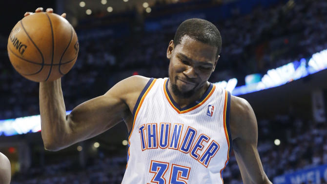 Oklahoma City Thunder forward Kevin Durant (35) reacts to a basket by Memphis Grizzlies' Zach Randolph during the first half of Game 5 of an NBA basketball playoffs Western Conference semifinal, in Oklahoma City, Wednesday, May 15, 2013.  (AP Photo/Sue Ogrocki)