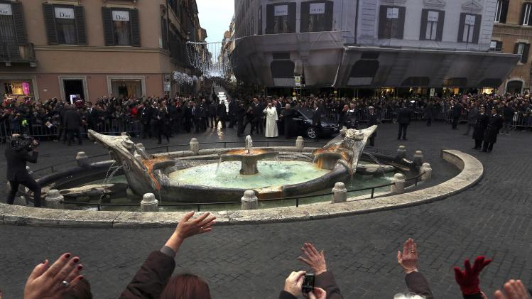 Pope Francis waves as he arrives to pay homage to the statue of the Madonna in Piazza di Spagna in Rome