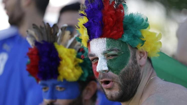 Italy fans stroll in downtown Manaus prior to the England vs Italy match during the 2014 soccer World Cup in Arena da Amazonia in Manaus, Brazil, Saturday, June 14, 2014