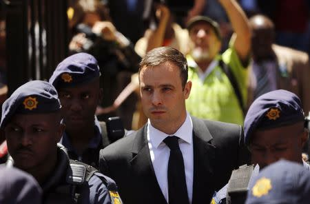 South African Olympic and Paralympic sprinter Oscar Pistorius leaves the North Gauteng High Court in Pretoria