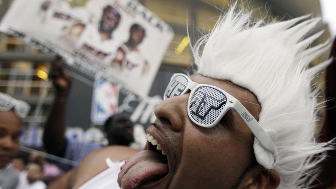 Miami Heat fan Rick Ramirez cheers the team before Game 5 of the NBA finals basketball series against the Oklahoma City Thunder, Thursday, June 21, 2012, in Miami. (AP Photo/Lynne Sladky)