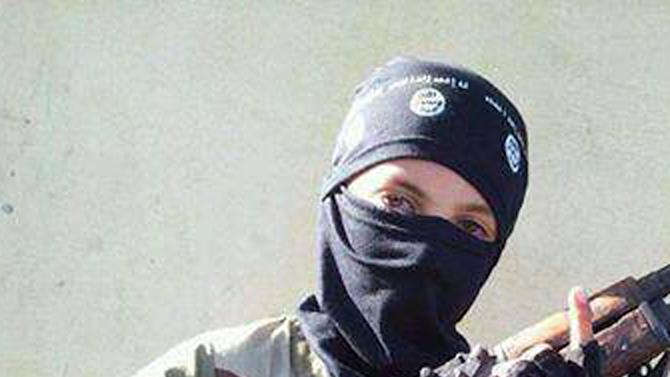 In this undated image posted online and made available on Thursday, Nov. 20, 2014, by Raqqa Is Being Slaughtered Silently, an anti-Islamic State group organization, a child wearing a hat with the Islamic State group logo poses with a weapon in Raqqa, Syria. The image has been verified and is consistent with other AP reporting. Across the vast region in Syria and Iraq that is part of the Islamic State group's self-declared caliphate, children are being inculcated with the extremist group's radical and violent interpretation of Shariah law. (AP Photo/Raqqa Is Being Slaughtered Silently)