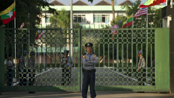 A police officer stands guard outside the Yangon Parliament house, where American President Barack Obama is scheduled to meet Myanmar's President Thein Sein in Yangon, Myanmar, Monday, Nov. 19, 2012.  Obama is set to become the first U.S. president to visit Myanmar with Air Force One scheduled to touch down in Yangon on Monday morning. (AP Photo/Gemunu Amarasinghe)