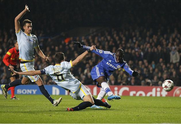 Chelsea's Demba Ba, right, shoots to score against Steaua Bucharest but is ruled offside during their Champions League group E soccer match at Stamford Bridge, London, Wednesday, Dec. 11, 2013