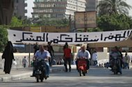 "A banner in Arabic across a Cairo street reads ""May God bring down the military rule"". Campaigning for Egypt's presidential election next month officially began on Monday, with Islamists and liberal secularists expected to dominate the hustings"