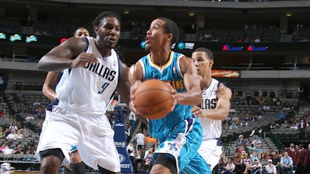 Brian Roberts #22 of the New Orleans Hornets drives against Jae Crowder #9 of the Dallas Mavericks during the game between the New Orleans Hornets and the Dallas Mavericks
