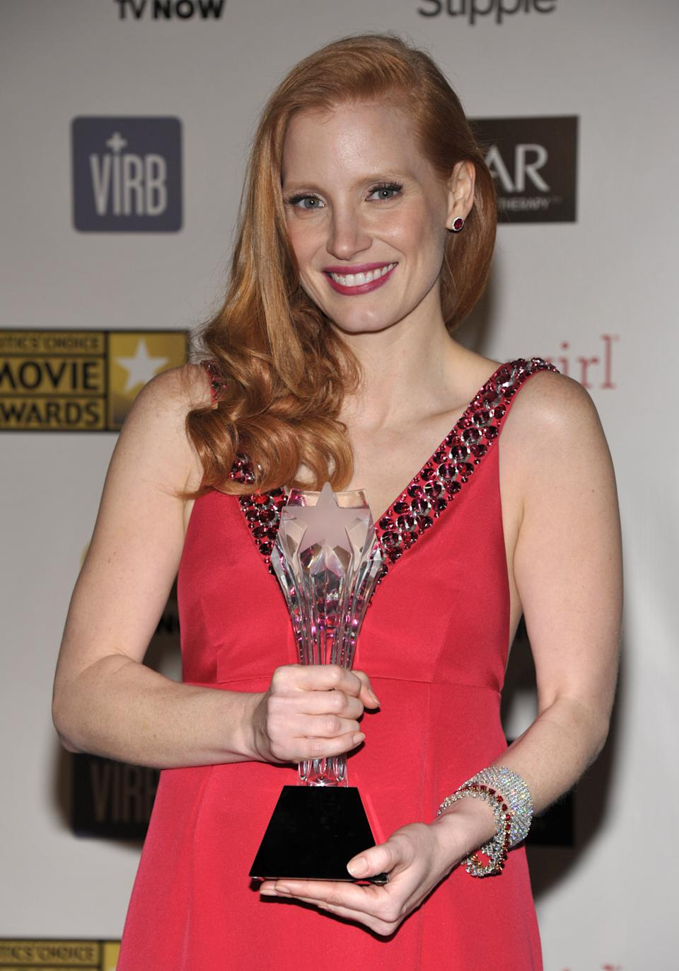 "Jessica Chastain poses backstage with the award for best actress for ""Zero Dark Thirty"" at the 18th Annual Critics' Choice Movie Awards at the Barker Hangar on Thursday, Jan. 10, 2013, in Santa Monica, Calif. (Photo by John Shearer/Invision/AP)"