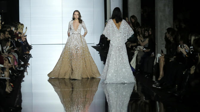 Models wear creations for Zuhair Murad's Spring-Summer 2015 Haute Couture fashion collection presented  in Paris, France, Thursday, Jan. 29, 2015. (AP Photo/Jacques Brinon)