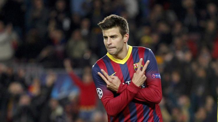 Barcelona's Pique celebrates after scoring a goal against Celtic during their Champions League soccer match in Barcelona