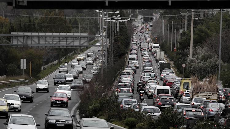 Cars are caught in a traffic jam during a strike by metro employees and work stoppage held by urban railway, metro, bus and trolley unions in Athens, Thursday, Jan. 24, 2013. Greece's conservative prime minister is holding emergency meeting after a deadline for striking public transport workers expired, leaving Athens' subway system closed for an eighth day. Strikers protesting pay cuts refused to return to work Thursday despite a court decision declaring their protest illegal. (AP Photo/Petros Giannakouris)
