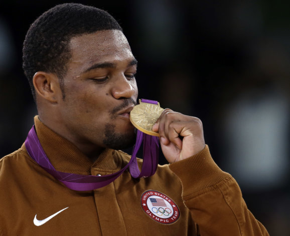 Gold medalist United States' Jordan Ernest Burroughs, participates in the medals ceremony for men's 74-kg freestyle wrestling competition at the 2012 Summer Olympics, Friday, Aug. 10, 2012, in London. (AP Photo/Paul Sancya)
