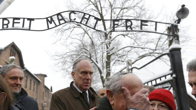 Ronen of Canada, a survivor of the former German Nazi concentration and extermination camp Auschwitz reacts next to the World Jewish Congress President Lauder as they visit the camp in Oswiecim