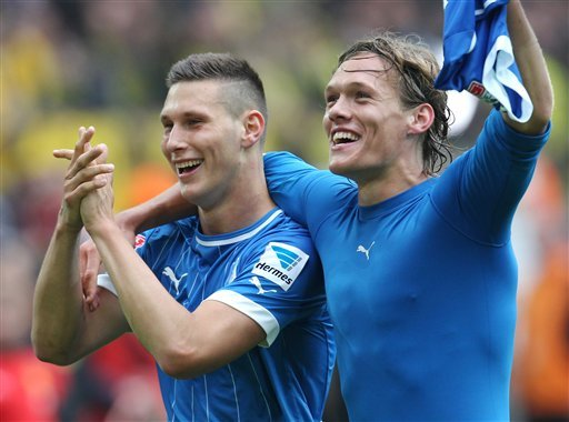 Hoffenheim's Matthieu Delpierre of France and Hoffenheim's Jannik Vestergaard of Denmark celebrate after winning 2-1 in the German first division Bundesliga soccer match between Borussia Dortmund and