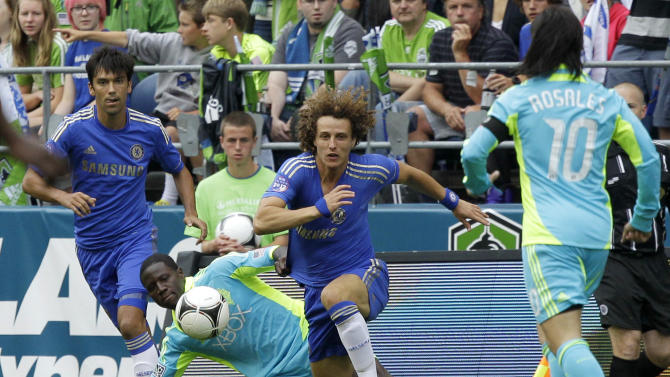 Chelsea's David Luiz, second from right, and Paulo Ferreira, left, work against Seattle Sounders' Jhon Kennedy Hurtado, second from left, and Mauro Rosales, right, in the first half of an exhibition soccer match, Wednesday, July 18, 2012, in Seattle. (AP Photo/Ted S. Warren)