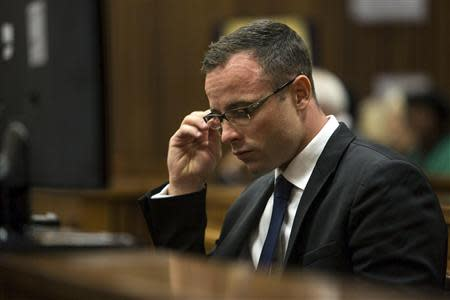 Olympic and Paralympic track star Oscar Pistorius sits in the dock at the North Gauteng High Court in Pretoria,