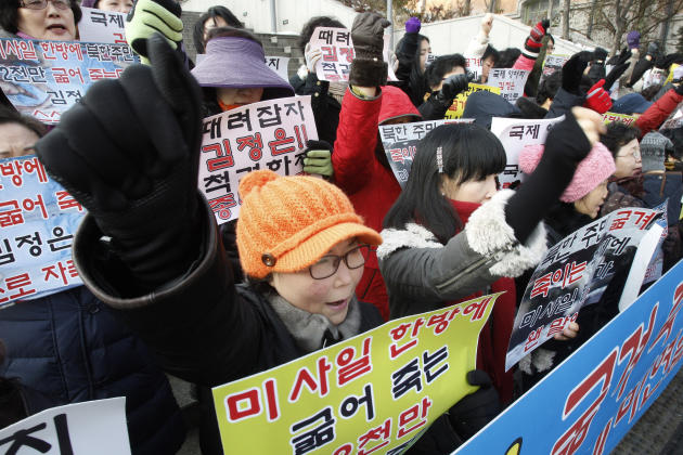 South Korean house wives shout slogans during a rally denouncing North Korea's rocket launch in Seoul, South Korea, Thursday, Dec. 13, 2012. North Korea successfully fired a long-range rocket on Wedne