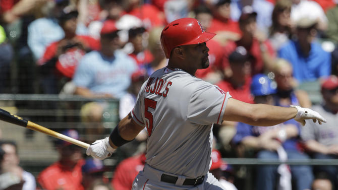 Los Angeles Angels' Albert Pujols (5) lines out to Texas Rangers shortstop Elvis Andrus in the first inning of a baseball game Friday, April 5, 2013, in Arlington, Texas. (AP Photo/Tony Gutierrez)