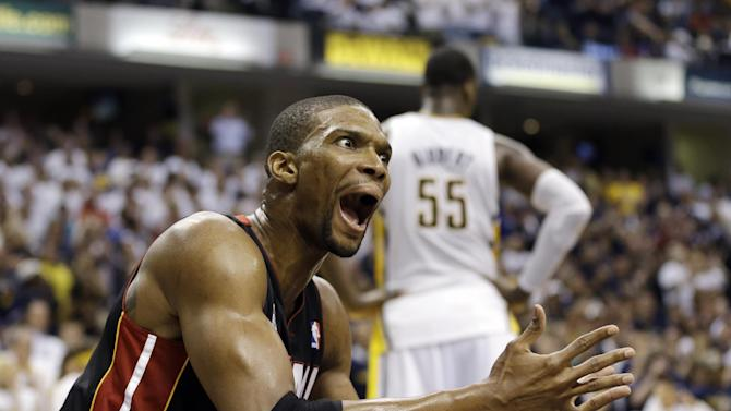 Miami Heat's Chris Bosh reacts after getting called for a foul against Indiana Pacers' Lance Stephenson during the second half of Game 3 of the NBA Eastern Conference basketball finals in Indianapolis, Sunday, May 26, 2013. (AP Photo/Nam H. Huh)