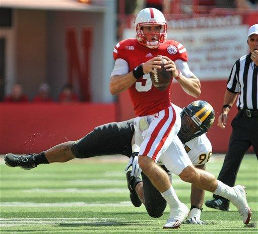Martinez's big day leads No. 17 Neb. to 49-20 win