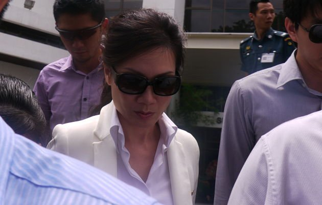 Cecilia Sue Siew Nang was escorted when she made a court appearance for the third day of the trial. (Yahoo! photo/ Deborah Choo)