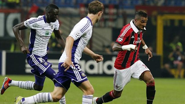 AC Milan's Kevin Prince Boateng runs with the ball as Guillaume Gillet of Anderlecht challenges him in the Champions League at the San Siro (Reuters)