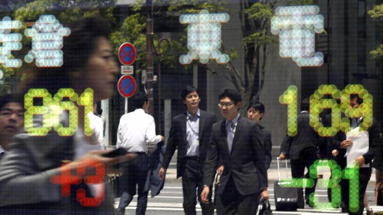 Pedestrians are reflected on the electronic stock board of a securities firm with the day's price of the Tokyo Electric Power Co (TEPCO) seen at right, yellow, in Tokyo Thursday, June 9, 2011. The stock price of TPECO, which has the tsunami-crippled Fukushima Dai-ichi nuclear plant,  tumbled to  a new low in a trading session Thursday since TEPCO got listed.  The March 11 earthquake and tsunami left more than 23,000 people dead or missing, and wiped out entire towns in the hardest-hit areas. Damage is estimated at $300 billion, making it the most expensive natural disaster in history. (AP Photo/Koji Sasahara)