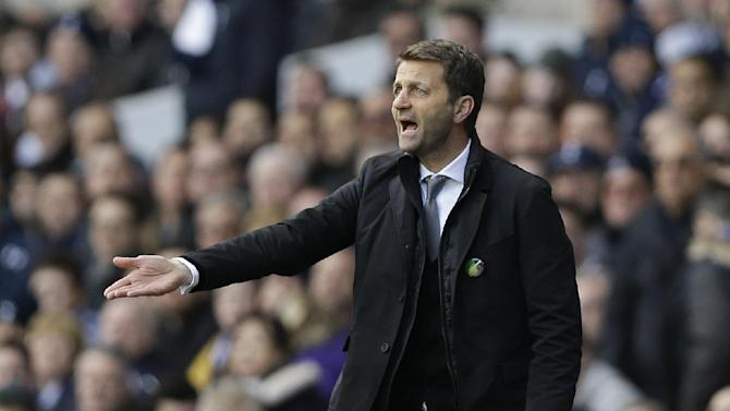 Tottenham's manager Tim Sherwood directs his players during the English Premier League soccer match between Tottenham Hotspur and Southampton at White Hart Lane stadium in London, Sunday, March 23, 2014