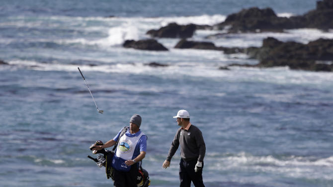 Matt Every, right, watches his club bounce after slamming it to the ground after hitting from the ninth fairway of the Pebble Beach Golf Links during the first round of the AT&T Pebble Beach Pro-Am golf tournament Thursday, Feb. 7, 2013, in Pebble Beach, Calif. (AP Photo/Eric Risberg)