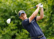 Luke Donald of England hits his tee shot on the second hole during the final round of the Zurich Classic of New Orleans at TPC Louisiana in Avondale, Louisiana
