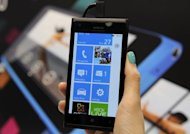 Nokia cut its first quarter operating margin outlook as fierce competition hurt its mobile phone sales, sending the company's share price plunging more than 16 percent