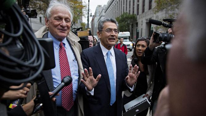 Rajat Gupta, center, leaves federal court in New York on Wednesday, Oct. 24, 2012 after the former Goldman Sachs and Procter & Gamble Co. board member was sentenced Wednesday to 2 years in prison for feeding inside information about board dealings with a billionaire hedge fund owner who was his friend. At left is Gupta's attorney, Gary Naftalis. (AP Photo/Craig Ruttle)