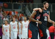 US forward Kevin Love (R) and US gard James Harden celebrate at the end of the Men&#39;s preliminary round group A basketball match of the London 2012 Olympic Games Tunisia vs USA at the basketball arena in London. USA won 110 to 63