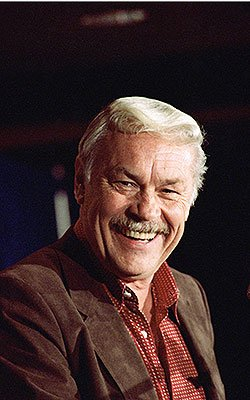 Buss' savvy real-estate investments helped make him a fortune. (Getty Images)