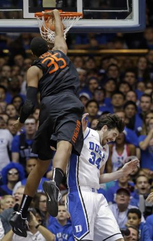 Miami's Kenny Kadji (35) dunks over Duke defender Ryan Kelly during the first half of an NCAA college basketball game in Durham, N.C., Saturday, March 2, 2013. (AP Photo/Gerry Broome)