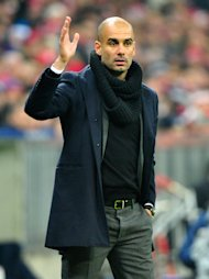 MUNICH, GERMANY - DECEMBER 10: Head coach Josep Guardiola of Muenchen reacts during the UEFA Champions League Group D match between FC Bayern Muenchen and Manchester City at Allianz Arena on December 10, 2013 in Munich, Germany. (Photo by Lennart Preiss/Bongarts/Getty Images)