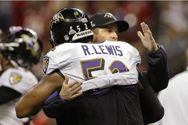 Baltimore Ravens head coach John Harbaugh hugs linebacker Ray Lewis (52) before playing the San Francisco 49ers in the NFL Super Bowl XLVII football game, Sunday, Feb. 3, 2013, in New Orleans. (AP Pho