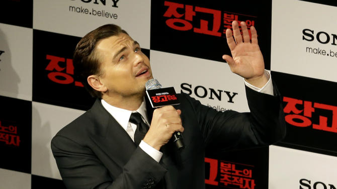 "Actor Leonardo DiCaprio waves to fans upon arriving for the premiere of his new film ""Django Unchained"" in Seoul, South Korea, Thursday, March 7, 2013. DiCaprio is in Seoul to promote the film which is to be released in South Korea on March 21. (AP Photo/Lee Jin-man)"