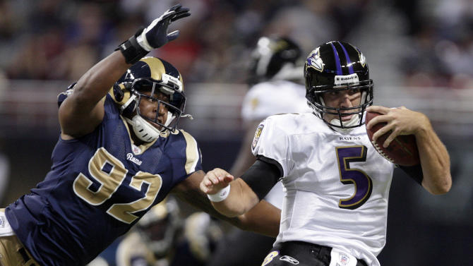 Baltimore Ravens quarterback Joe Flacco, right, scrambles for yardage as St. Louis Rams defensive end Eugene Sims, left, defends during the first quarter of an NFL football game on Sunday, Sept. 25, 2011, in St. Louis. (AP Photo/Tom Gannam)