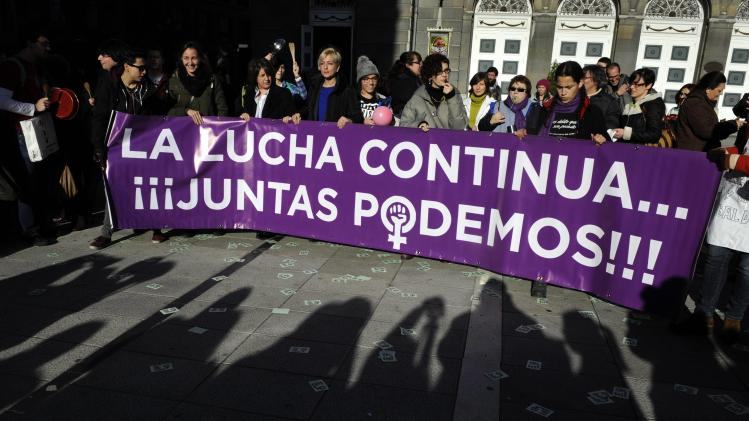 Pro-choice demonstrators take part in a rally in Oviedo