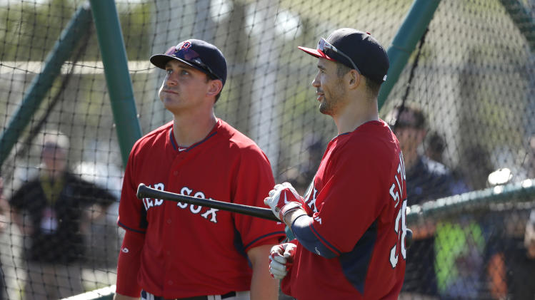 Boston Red Sox third baseman Will Middlebrooks, left, talks with Boston Red Sox center fielder Grady Sizemore, right, during spring training baseball practice Tuesday, Feb. 18, 2014, in Fort Myers, Fla. (AP Photo/Steven Senne)