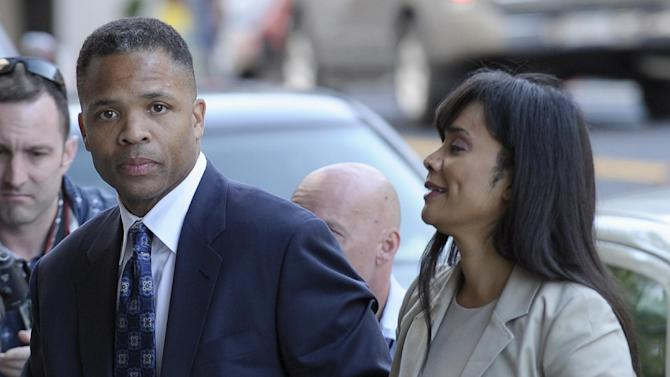 FILE - In this Wednesday, Aug. 14, 2013, file photo, former Illinois Rep. Jesse Jackson Jr. and his wife, Sandra, arrive at federal court in Washington, to learn their fates when a federal judge sentences the one-time power couple for misusing $750,000 in campaign money on everything from a gold-plated Rolex watch and mink capes to vacations and mounted elk heads. Jesse Jackson Jr.'s posessions _ including fur capes and Michael Jackson memorabilia _ go on the auction block Tuesday, Sept. 17, 2013, in an attempt to generate cash to pay his $750,000 fine for fundraising violations. (AP Photo/Susan Walsh, File)