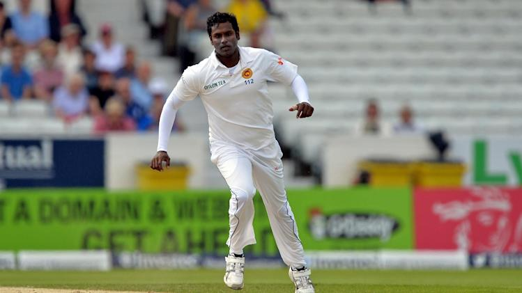 Sri Lanka bowler Shaminda Eranga watches the ball on the third day of the second test match between England and Sri Lanka at Headingley in Leeds on June 22, 2014