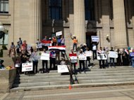 Two separate group with ties to Egypt rallied in Winnipeg calling for an end to the violence in that country.