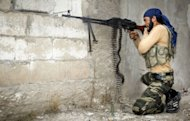 A rebel fighter fires at Syrian government troops at the citadel in the town of Harem, on the Turkish border, on October 31, 2012. Syria's main anti-regime group said Friday the US was undermining the country's revolt by seeking an opposition overhaul, as the UN accused rebels of possible war crimes over a video showing soldiers being executed