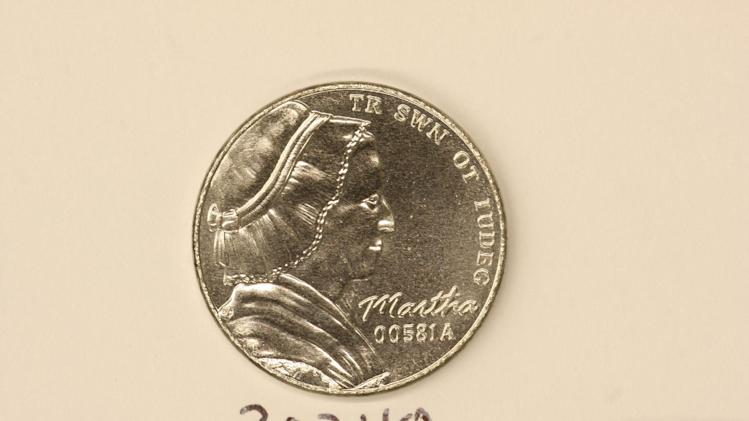 This undated photo provided on Wednesday, Dec. 19, 2012 by the U.S. Mint in Philadelphia shows a bonneted Martha Washington on a nonsense test piece.  The Mint has been testing different materials to fiend less expensive ways to make coins. (AP Photo U.S. Mint)