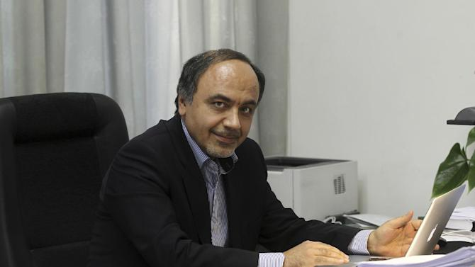 In this undated photo provided by the office of the Iranian President, Hamid Aboutalebi, an Iranian diplomat, who was recently named as Iran's ambassador at the United Nations, sits in his office in Tehran, Iran. Iran has no plans to name a new diplomat to the United Nations, its Foreign Ministry said Saturday April 12, 2014, after the United States blocked its pick in a rare rebuke that could stir fresh animosity at a time when the two countries have been seeking a thaw in relations. The Obama administration said Friday that the U.S. had informed Iran it would not grant a visa to Hamid Aboutalebi, a member of the group responsible for the 1979 takeover of the U.S. Embassy in Tehran. (AP Photo/Iranian Presidency, Mohammad Berno)